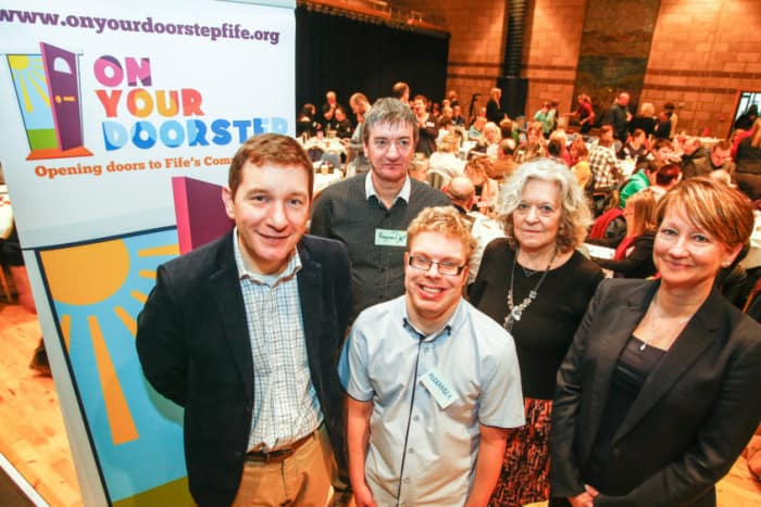 Launching the 'On Your Doorstep' website are Cormac Russell, managing director of Nurture Development; Alexander Warren (front); Raymond Brennan; Sheena Robertson, service manager; and Julie Paterson, divisional general manager.